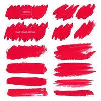 Ensemble de coups de pinceau rouge sur fond blanc