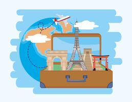 Montage de voyage avec des monuments célèbres dans une valise