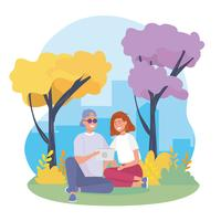 Jeune couple avec tablette assis dans le parc vecteur