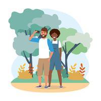 Homme et femme avec smartphone dans le parc vecteur