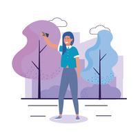 Jeune femme prenant selfie dans le parc vecteur