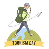 garçon marchant autour du globe jour du tourisme d'aventure