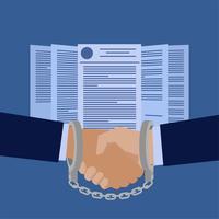 Poignée de main attachée par des menottes devant des papiers contractuels