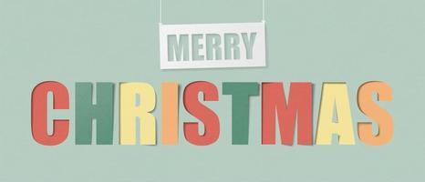 Joyeux Noël calligraphie colorée en style de papier découpé vecteur