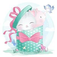 Chatons mignons assis à l'intérieur d'une boîte-cadeau