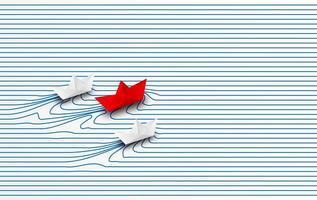 Bateau en papier rouge menant des bateaux en papier blanc à travers l'eau jusqu'au but