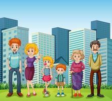 Une famille devant les grands immeubles de la ville