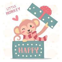 Sourire heureux petit singe avec une écharpe rouge apparaît dans une boîte cadeau
