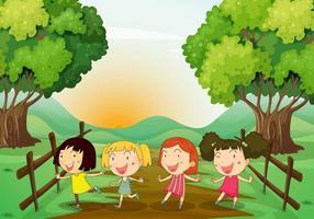 Quatre jeunes filles jouant à l'extérieur