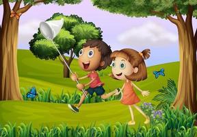 Deux enfants jouent dans la forêt avec un filet vecteur