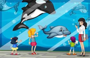 Enfants regardant les dauphins à l'aquarium vecteur