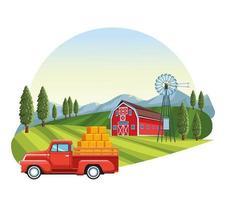 Camion suv transportant paille avec grange en arrière-plan