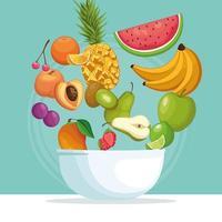 bol de fruits avec des fruits dans l'air