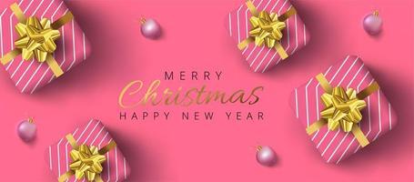 Bannière de Noël avec des boules en or, boîtes de cadeau réalistes roses et fond