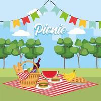 panier avec des fruits sains dans la nappe et les drapeaux de fête