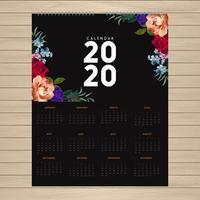 Conception de calendrier 2020 avec des fleurs dans les coins vecteur