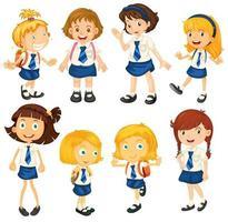Huit écolières en uniforme vecteur