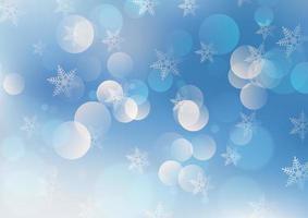 Fond de Noël avec des lumières bokeh et des flocons de neige