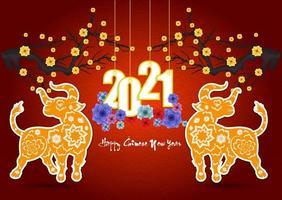affiche du nouvel an chinois 2021 avec des fleurs et des bœufs vecteur