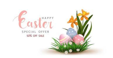 affiche de vente de Pâques avec des oeufs dans l'herbe