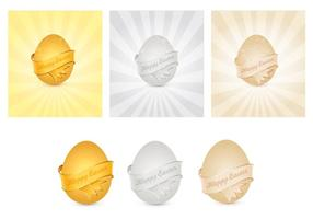 Vecteurs d'oeufs de pâques d'or, d'argent et de bronze