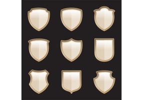 Vecteurs de bouclier héraldique d'or vecteur