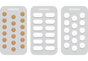 Pilules blanches en blisters vecteur