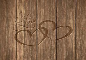 Cœur libre gravé dans le fond du vecteur de bois