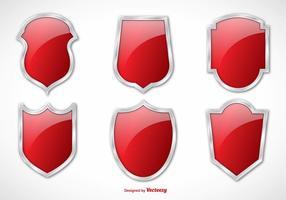 Boucliers vectoriels rouges en argent vecteur