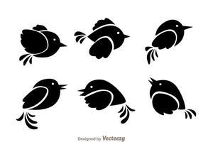 Vecteurs noirs d'oiseaux volants vecteur