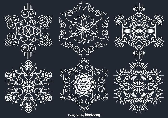 Flocos de neve brancos ornamentais brancos vetor