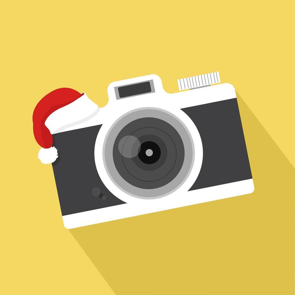 câmera plana vintage com chapéu natal vetor