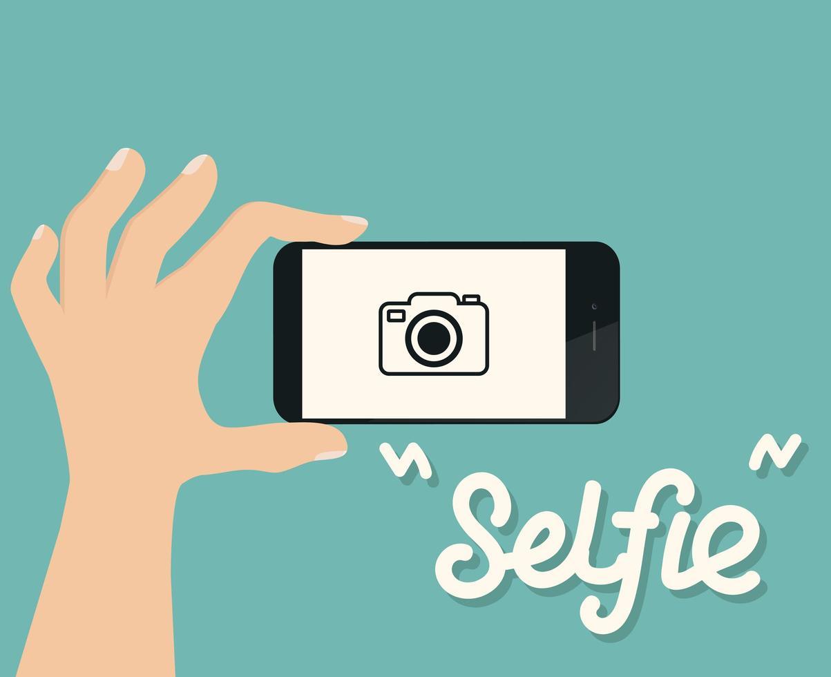 mão usando um smartphone para tirar uma selfie vetor