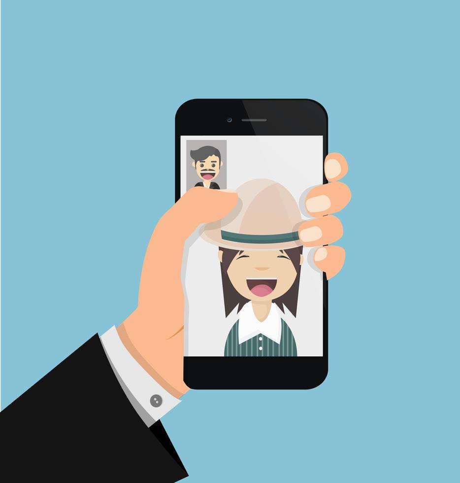 mão segurando um smartphone para fazer um bate-papo por vídeo vetor