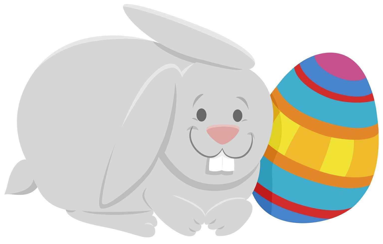 desenho animado coelhinho da páscoa com ovo da páscoa colorido vetor