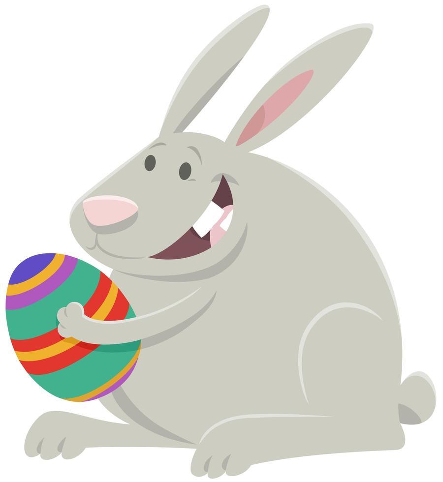 desenho animado coelhinho da páscoa com ovo da páscoa vetor