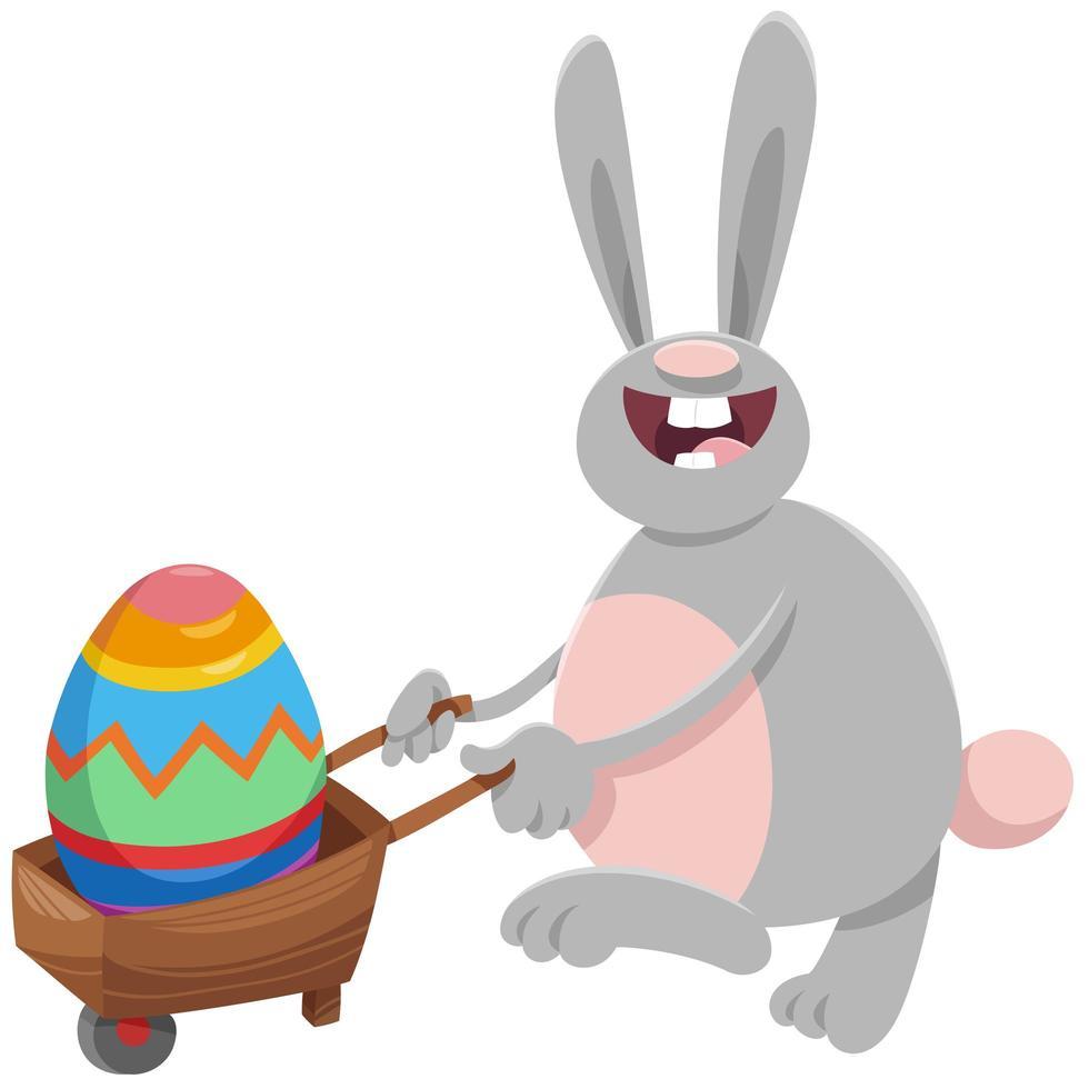 desenho animado coelhinho da Páscoa com ovo grande no carrinho de mão vetor