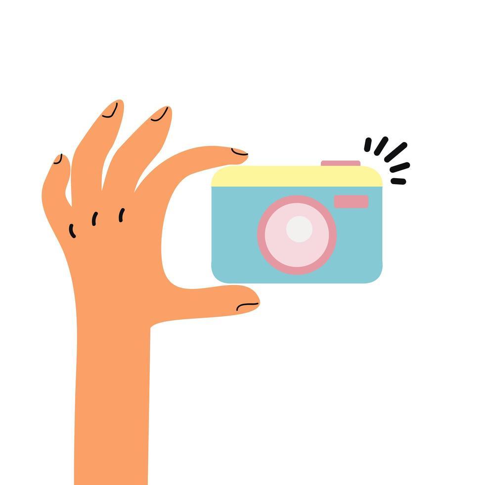 mão segurando um vetor de câmera fotográfica