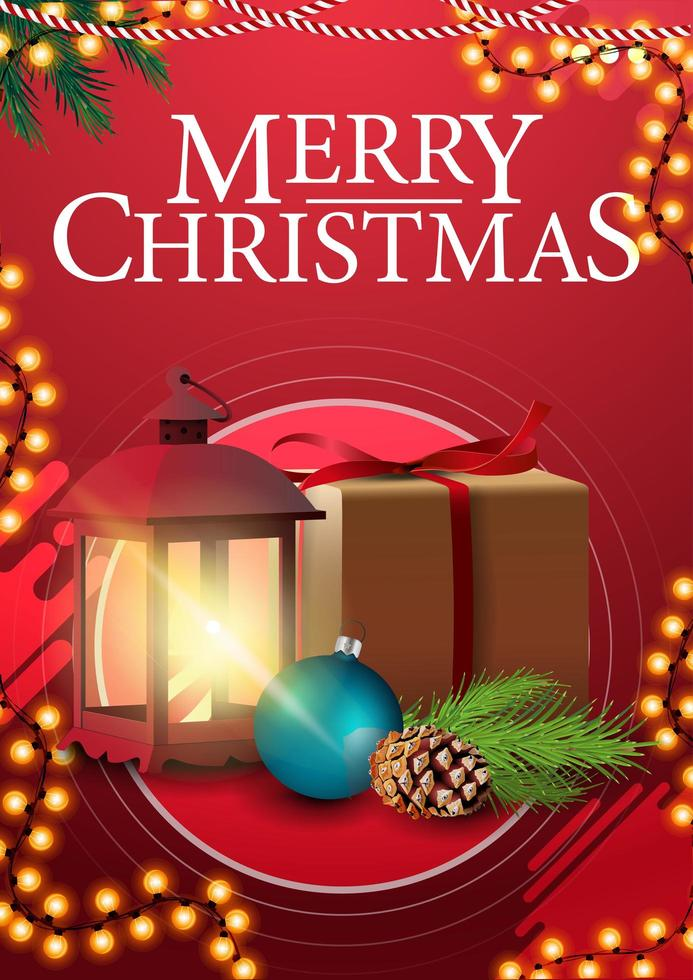 Feliz Natal, cartaz de saudações vertical vermelho com guirlanda de moldura, presente, lanterna vintage, galho de árvore de Natal com um cone e uma bola de Natal vetor