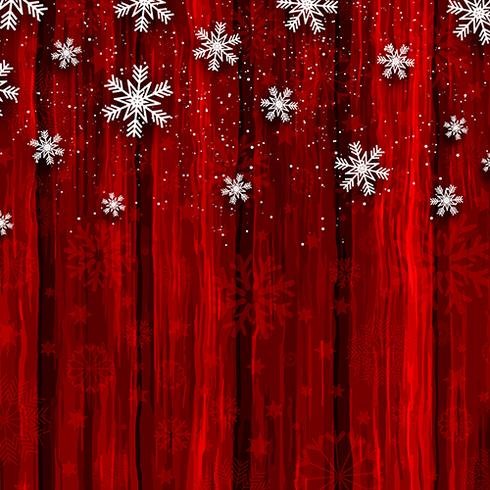 Flocos de neve de Natal no fundo madeira vermelho vetor