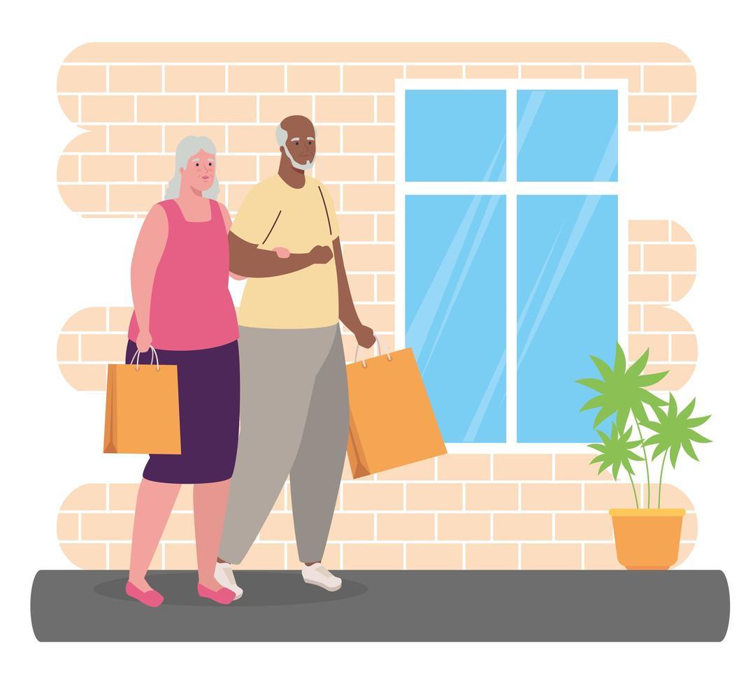 casal interracial fofo com sacolas de compras vetor