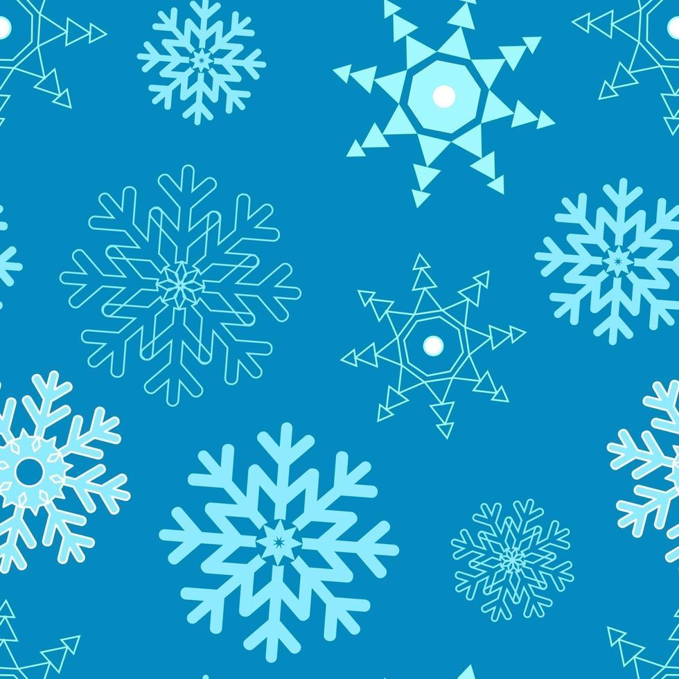 padrão de diferentes flocos de neve em um vetor de fundo azul