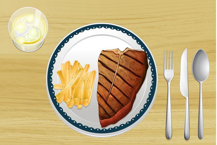 Bife e batatas fritas vetor