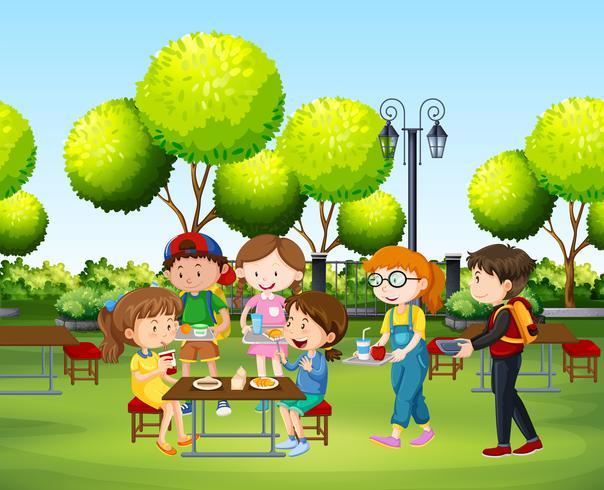 Pessoas comendo no parque durante o dia vetor