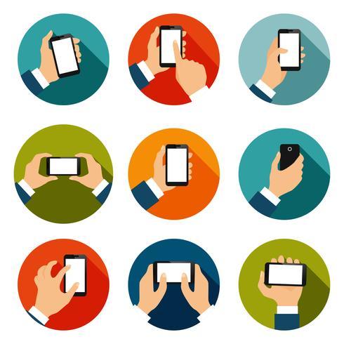 Mãos com conjunto de ícones de telefones vetor