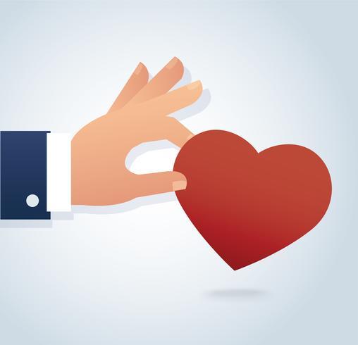mão segurando o vetor de coração vermelho