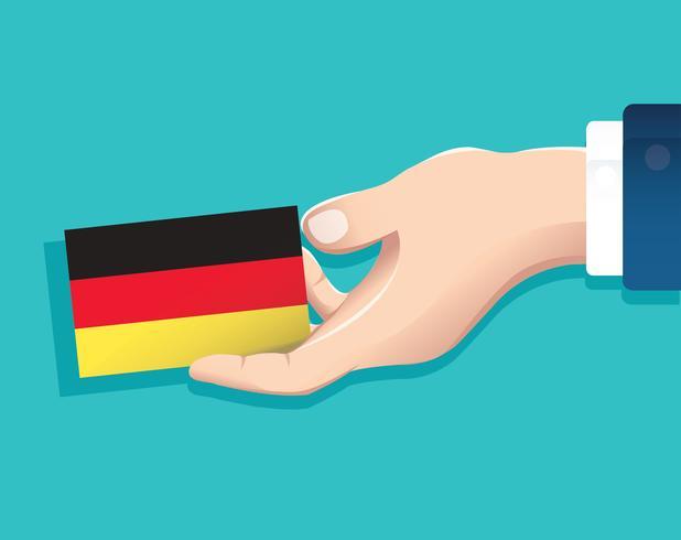 mão segurando o cartão de bandeira de Alemanha com fundo azul vetor