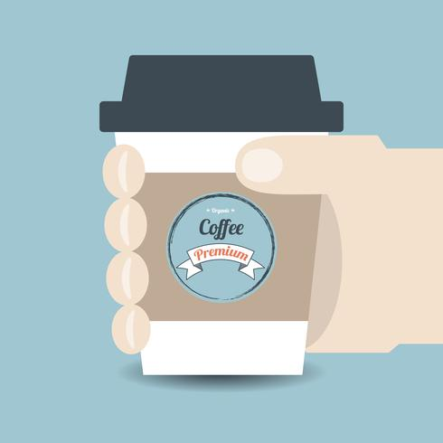 Mão segurando uma xícara de café vetor