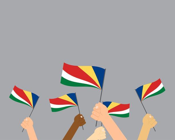 Ilustração em vetor de mãos segurando bandeiras Seychelles isoladas em fundo cinza