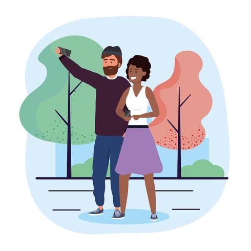 Casal tomando selfie no parque vetor